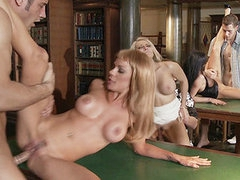 Check out this Orgy in the library with smokin' sexy babes