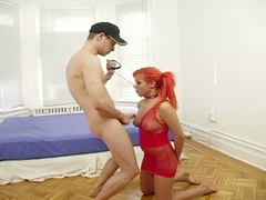 Tied up redhead gets drilled and face fucked