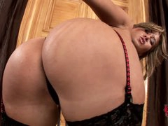 Lingerie-clad seductress Carmen in stockings shows off her bubble butt before she spreads her legs and gets her wet shaved pussy out to please herself.