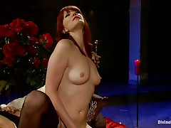 divine redhead bitch fucking a man with a strap on