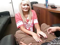 horny blonde giving a guy a handjob