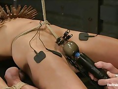The man is showing his skills in domination and punishment. He putted laundry pliers on this slut's tits and then suckers on her nipples before rubbing her clit with a vibrator. After rubbing that cunt nice and good he hangs her and probably has something very special for her ass, would u like to see that?