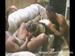 Retro cocksucker blows two black guys