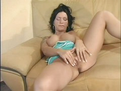 Raven haired busty Sabrina Dotee spreads her legs and strokes her hairless pussy like crazy in this solo scene. She can't stop rubbing her bare snatch. Sabrina Dotee puts her hands on her fake boobs from time to time.