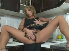 Long legged milf Tara Romain takes Steve's cock in her throat immediately after masturbating with dildo on the kitchen counter. She sucks his rod like crazy and then suggests her oozing wet pussy to hot guy.