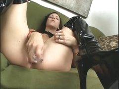 Horny girl in black latex boots masturbates