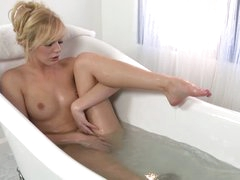 Stripped blond Hayden Hawkens plays with herself while taking a bath. She touches smooth snatch between her legs under water. Finally she leaves the bathtub and takes pink vibrator.