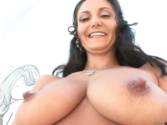 Black haired curvy woman Ava Addams shows off her amazing big jugs and big bubble ass. Stud behind the camera is Mike Adriano. He touches her amazing body!