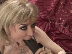 Nina Hartley is a good looking busty mature floozy that is hungry for big black dick. That babe takes nice size dark sausage in her experienced throat with big desire.