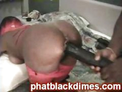 Naughty black ghetto freak gets drilled with big toy