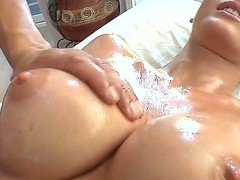 Alluring Jennifer Black gets a sensual oil massage from a hot masseur to sooth her longings away