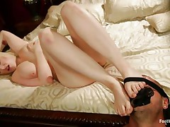 busty milky white blonde rubbing a hard cock with her feet
