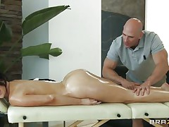 sexy brunette getting lewd at a massage