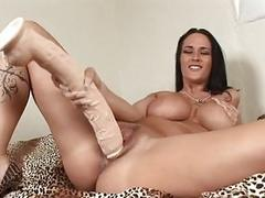 Heavy chested brunette sticks monster sex toy up her shaved taco