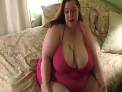 Very large women disrobes down to her panyhose and then shows large ass