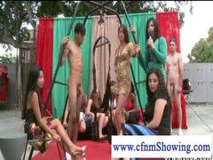 CFNM girls enjoying men in swing ready to be blowed off