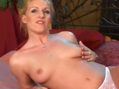 Busty masturbating blonde chick alone in couch