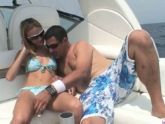 Blonde michelle lays on the boat and gets her cookie licked