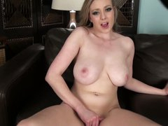 Busty Sapphire Blue is lonely but horny. This babe takes off her panties and strokes her juicy pussy hard with her hand. Then big meloned lady takes her new toy!