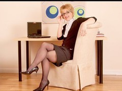 Hawt older business woman in glasses fingers her muff