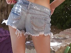 sexy teen fingering her pussy outdoors