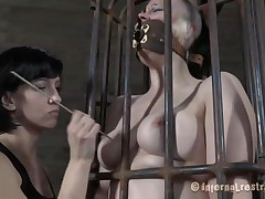 Yeah bitch, you deserve this punishment. You thought that everything needs to be your way and always had lack of respect. Let's see you in that cage how punk you are now. It's a bit humiliating for such a bad ass girl like you to be caged, tied and cunt rubbed isn't it? Stay there and shut the fuck up.