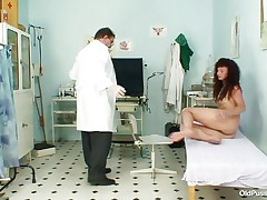 brunette aged with tight vagina at her gynecologist