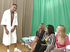three fully dressed milfs shaving a naked man