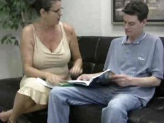 Busty mamma in glasses gives handy to teen guy