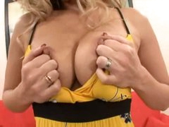 Happy blonde pulls tits from her dress