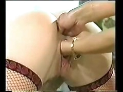 A wonderful double fisting for girl in fishnets