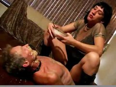 She spits food on slave face
