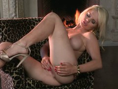 Stunning blond gal Alexis Ford shows off her killer boobs and toys her snatch in another hot solo video. She strips out of her underware and masturbates by the fireplace.
