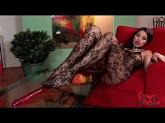 Glamorous girl in beautiful body stocking sucks her toes