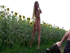 Alena posing between sunflowers