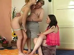 Dilettante threesome party where old and fat daddy fucks two girls