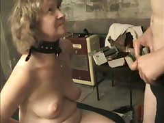 slave giving master a blowjob