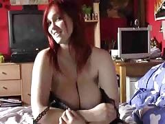 Busty Redhead masturbates