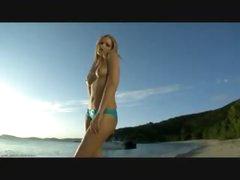 Ideal bikini girl on a beach gets sexy