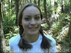 Pigtail Cutie gives blowjob in the forest