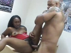 Ebony girl in corset loves that hard cock