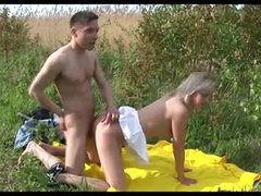Cute pair fucking in a field outdoors