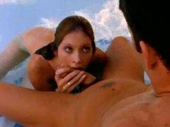 Girl in the pool sucks on a big cock