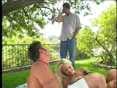 Good friends having a busty blond picnic