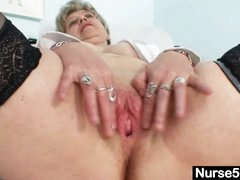 Busty granny in uniform stretching her mature cum-hole