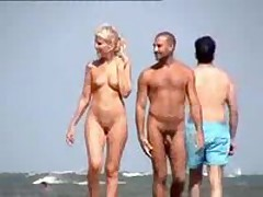 Nude couple filmed walking along the beach, nice blonde with cute billibongs and shaved pussy.