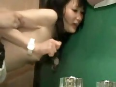 Oriental couple in bathroom