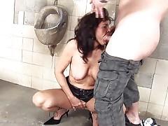 dirty cougar slut fucking in a public toilet