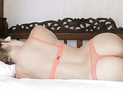 blonde beauty with perfect ass relaxing on the bed