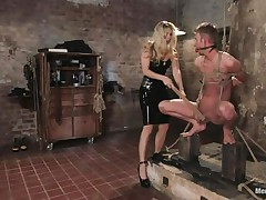 blond mistress inducing pain to her sex slave